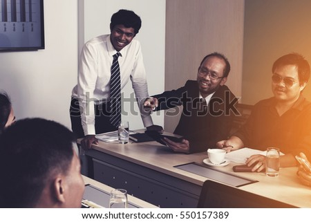 business teamwork discussing ideas and planning about profits summary at meeting room