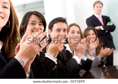 Business teamwork for success in an office - focus is on the first set of hands on the left - stock photo