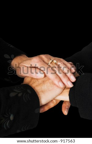 business teamwork hands over a black background