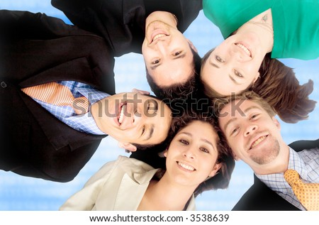 business teamwork - heads together over a technology blue background - stock photo