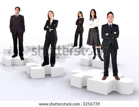 business teamwork on puzzle pieces over a white background - stock photo