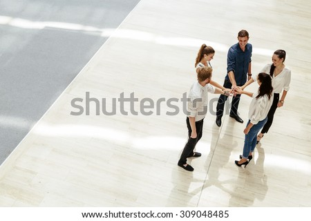 Business teamwork. People with joined hands. Union. Top View - stock photo