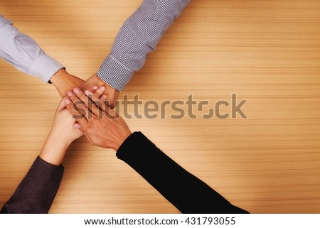 Business teamwork standing hands together in the office with copy space. Business people joining hands together.People Teamwork hands. together,teamwork online.business teamwork,join hands together  - stock photo