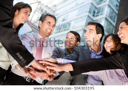 Business teamwork with a group of people with hands together - stock photo
