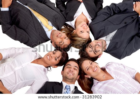 business teamwork with heads together on the floor isolated