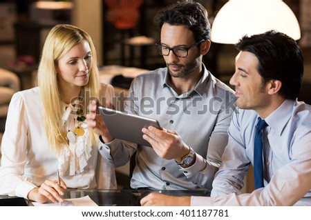 Business teamwork working in office till late in night. Business team working together on project. Business people completing work as per deadline given. Businesspeople working late. - stock photo