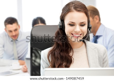 business, technology and call center concept - helpline operator with headphones in call centre - stock photo