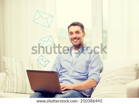 business, technology and e-learning concept - smiling man working with laptop at home - stock photo