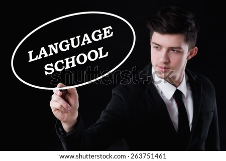 business, technology and internet concept - businessman is writing language school text - stock photo