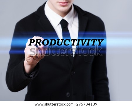 business, technology and internet concept - businessman is writing productivity text - stock photo