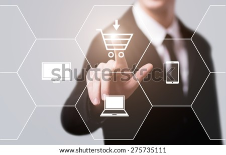 business, technology and internet concept - businessman pressing add to cart button on virtual screens - stock photo