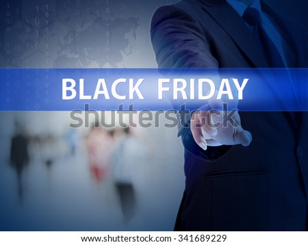 business, technology and internet concept - businessman pressing black friday button on virtual screens - stock photo