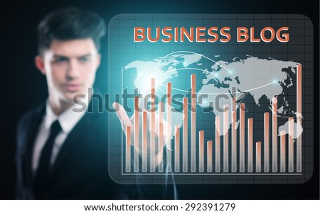 business, technology and internet concept - businessman pressing business blog button on virtual screens - stock photo