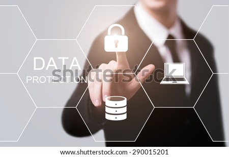 business, technology and internet concept - businessman pressing data protection button on virtual screens - stock photo