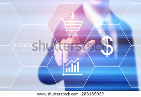 business, technology and internet concept - businessman pressing e-commerce button on virtual screens - stock photo