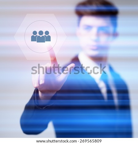 business, technology and internet concept - businessman pressing human resources button on virtual screens - stock photo