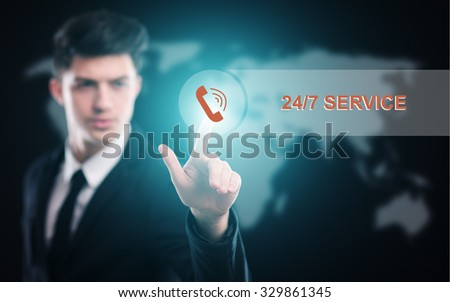 business, technology and internet  concept - businessman pressing 24/7 service button on virtual screens - stock photo