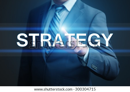 business, technology and internet concept - businessman pressing strategy button on virtual screens - stock photo