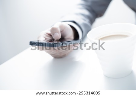 business, technology and internet concept - close up of man hands with coffee - stock photo