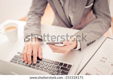 business, technology and internet concept - close up of man hands with coffee and laptop computer