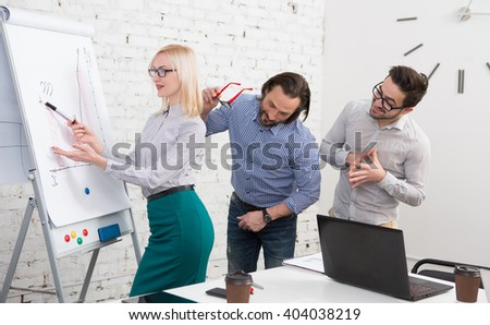 Business, technology and office concepts. Serious female boss talking to business team while men standing behind her. - stock photo