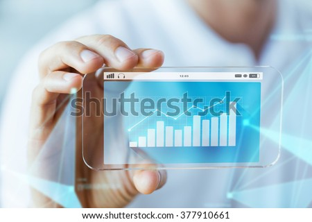 business, technology and people concept - close up of male hand holding and showing transparent smartphone with diagram chart on screen - stock photo