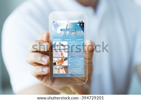 business, technology and people concept - close up of male hand holding and showing transparent smartphone with world news web page on screen - stock photo