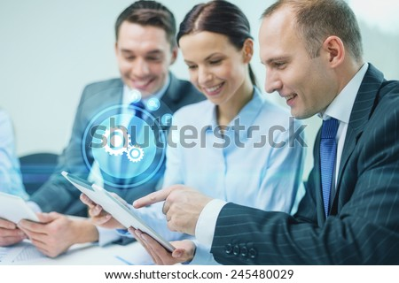 business, technology and people concept - smiling business team with tablet pc computer virtual settings projection having discussion in office - stock photo