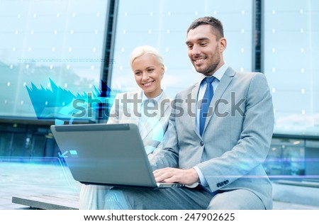 business, technology and people concept - smiling businesspeople working with laptop computer and virtual graph projection on city street - stock photo