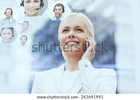 business, technology and people concept - smiling businesswoman with smartphone calling to helpline over office building