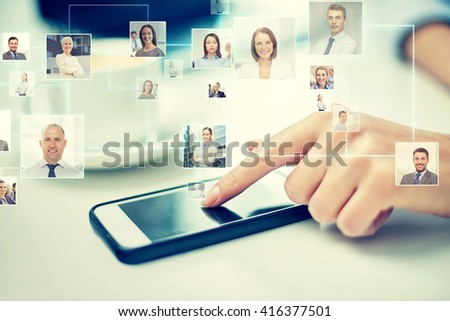 business, technology, global communication and people concept - close up of woman hand with smartphone and contact icons projection - stock photo