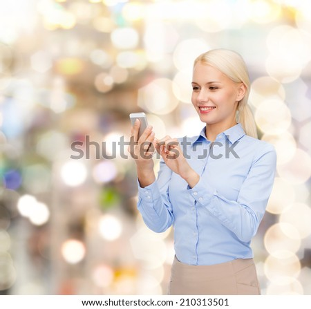 business, technology, holidays and people concept - smiling young businesswoman with smartphone - stock photo