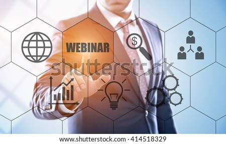 business, technology, internet and e-learning concept. Businessman pressing webinar button on virtual screens with hexagons and transparent honeycomb - stock photo