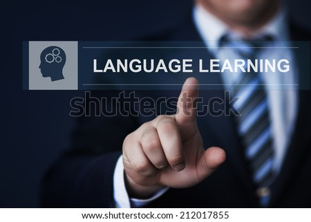 business, technology, internet and education concept - businessman pressing language learning button on virtual screens - stock photo