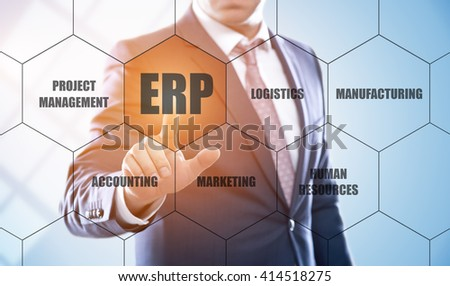 business, technology, internet and enterprise resource planning concept. Businessman pressing erp button on virtual screens with hexagons and transparent honeycomb - stock photo