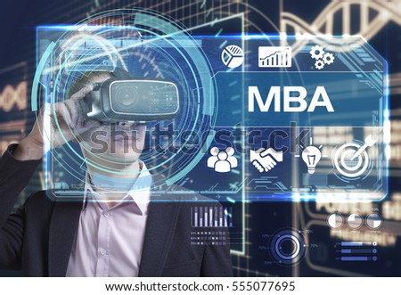 Business, Technology, Internet and network concept. Yong businessman working in virtual reality glasses sees the inscription: MBA