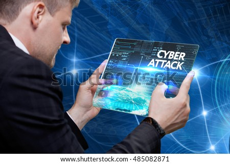 Business, Technology, Internet and network concept. Young business man, working on the tablet of the future, select on the virtual display: Cyber attack