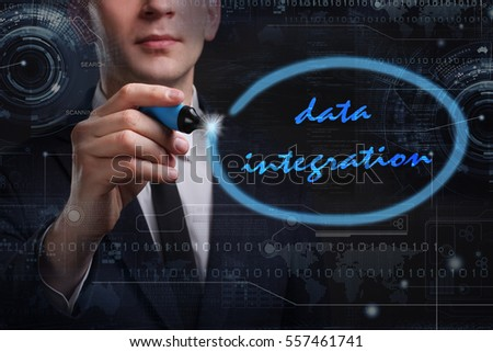 Business, Technology, Internet and network concept. Young business man writing word: data integration
