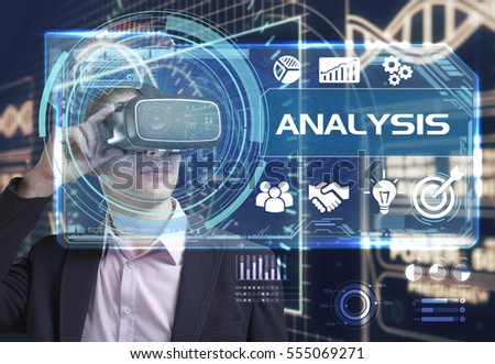 Business, Technology, Internet and network concept. Young businessman working in virtual reality glasses sees the inscription: Analysis
