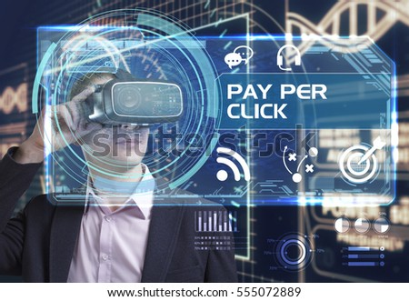 Business, Technology, Internet and network concept. Young businessman working in virtual reality glasses sees the inscription: pay per click
