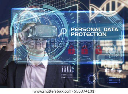 Business, Technology, Internet and network concept. Young businessman working in virtual reality glasses sees the inscription: personal data protection