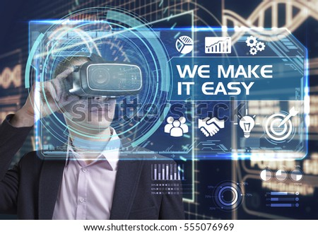 Business, Technology, Internet and network concept. Young businessman working in virtual reality glasses sees the inscription: we make it easy