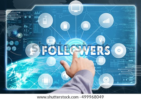 Business, Technology, Internet and network concept. Young businessman working on a virtual screen of the future and sees the inscription: Followers
