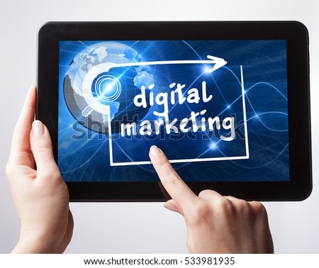 Business, Technology, Internet and network concept. Young businessman, working on the tablet , select on the virtual display: digital marketing