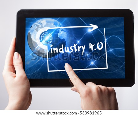 Business, Technology, Internet and network concept. Young businessman, working on the tablet , select on the virtual display: industry 4.0