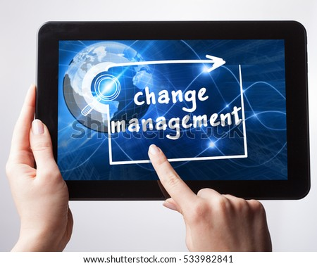 Business, Technology, Internet and network concept. Young businessman, working on the tablet , select on the virtual display: Change management