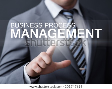 business, technology, internet and networking concept - businessman pressing business process management button on virtual screens - stock photo