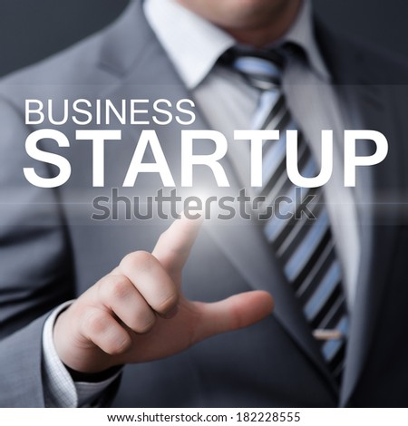 business, technology, internet and networking concept - businessman pressing business startup button on virtual screens - stock photo