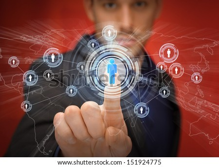 business, technology, internet and networking concept - businessman pressing button with contact on virtual screens - stock photo