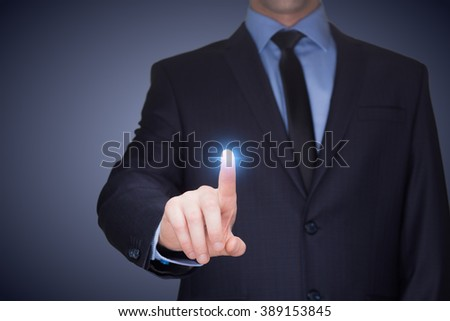 business, technology, internet and networking concept - businessman pressing button with contact on virtual screens.